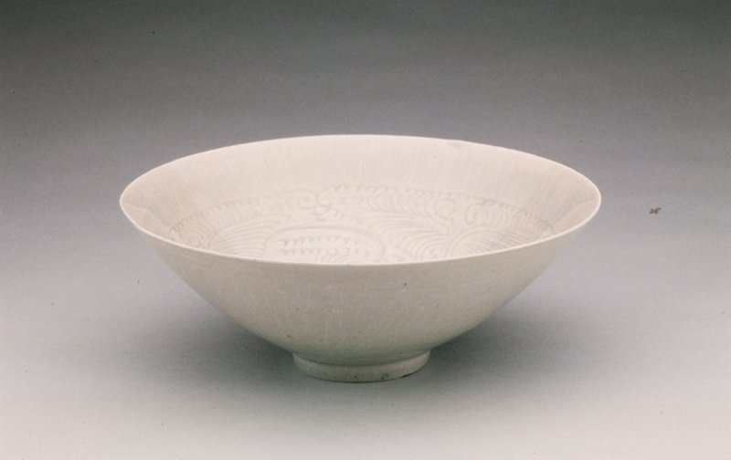 bowl depicting baby and floral spray design