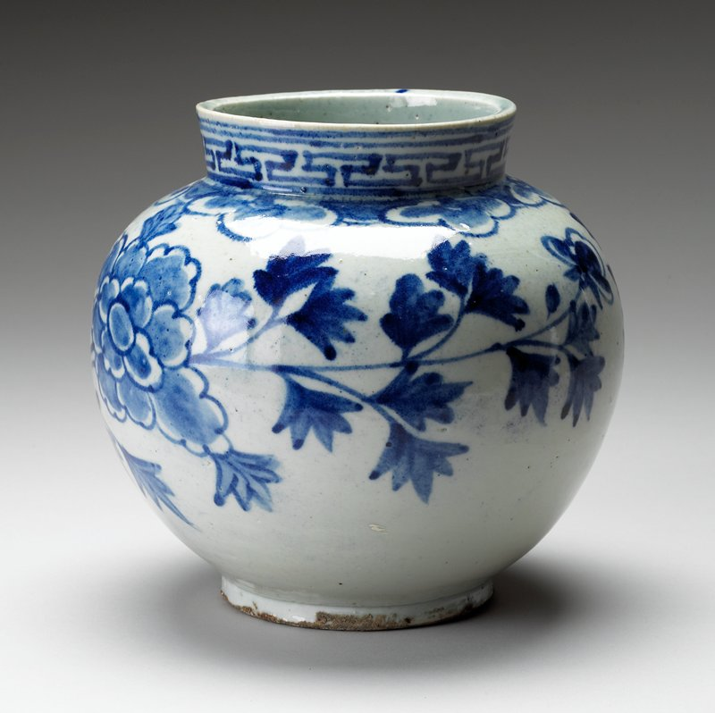 blue & white jar or vase with blue floral pattern; linear design on neck; other #'s J86