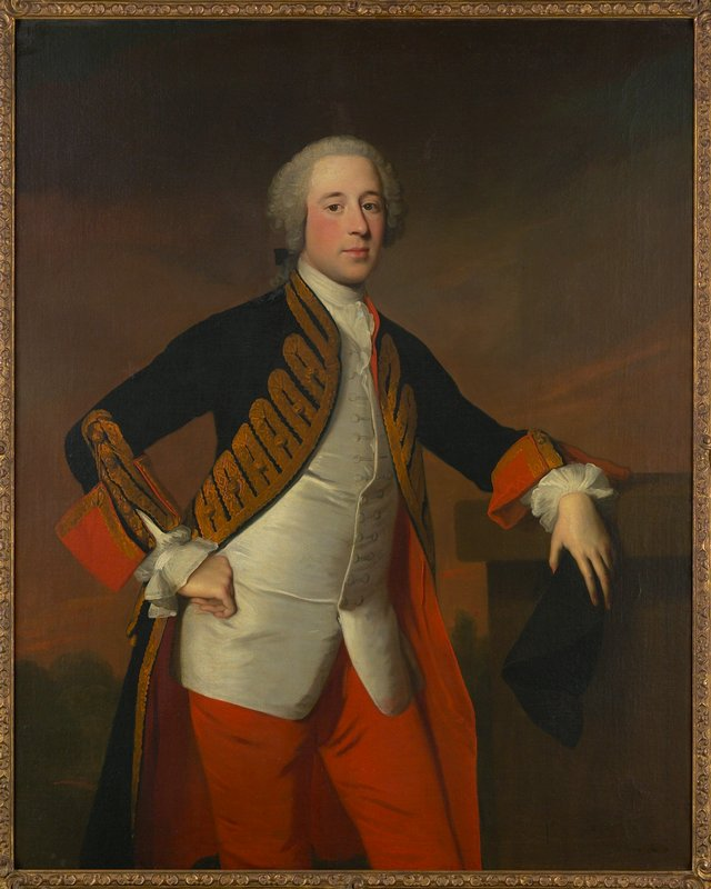 Portrait. Man dressed in red breeches and a blue velvet coat trimmed with gold braid and lined with crimson, is leaning with his left elbow on a column; dark blue tricorne in left hand; right hand on hip. He wears a white waistcoat and a white stock; frills at wrists. His slightly powdered hair is worn in a small peruke. Simple gold frame.