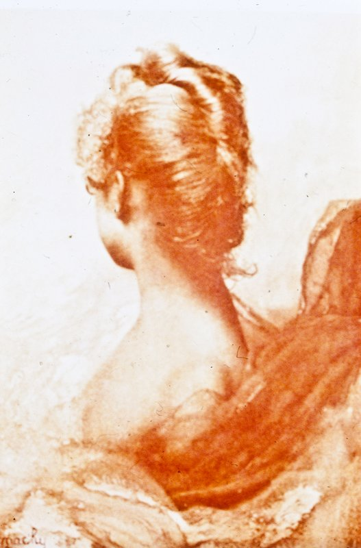 woman from shoulders up turns her head revealing a French twist; fabric swirls around her; orange hue to entire image