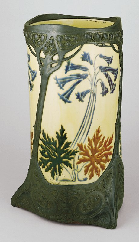 Ceramic with pewter mount in tri-footed cylindrical form