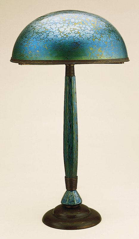 Bronze foot and mounts with paneled glass stem and dome-shaped art glass (papillon technique) shade