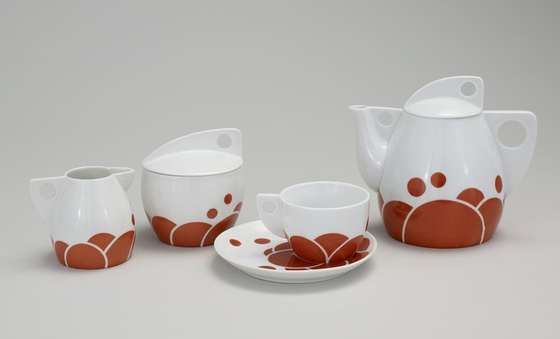 creamer with circular and semi-circular decoration on white ground; part of tea service which includes teapot and cup and saucer (L99.227.7.1-2), Norwest #87-4(teapot); 88-28, sugar bowl (L99.227.7.3a,b)