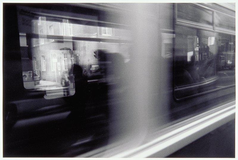 building viewed through train window
