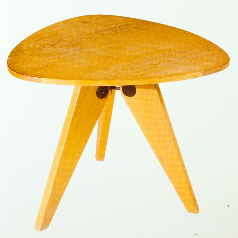 Three legs; table top has three rounded sides
