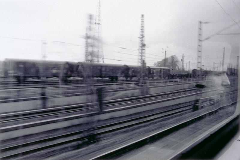 looking out window of fast moving train