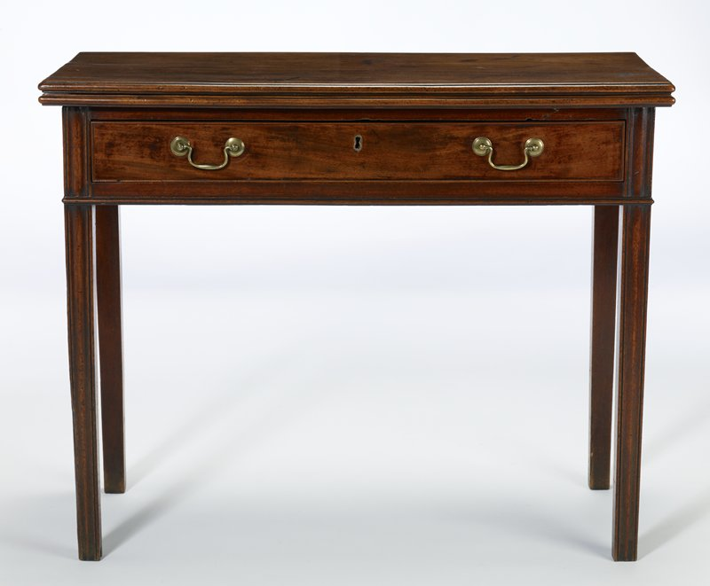table, folding card; drawer with brass bail handles and key plate; square moulding and slightly tapering legs, called 'finger print' design; entire piece has moulded edges throughout