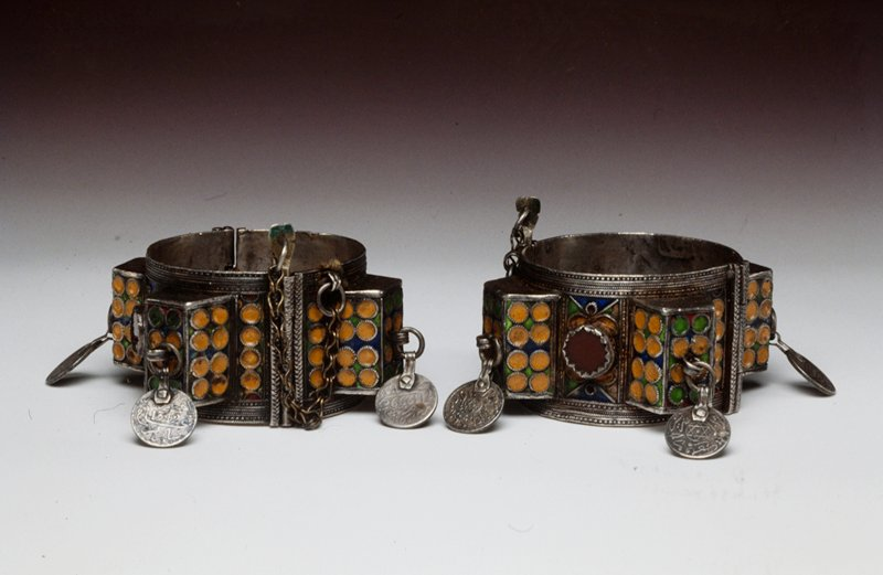 Pair of Bracelets metal; red glass; green, orange, blue, and red enamel; coins