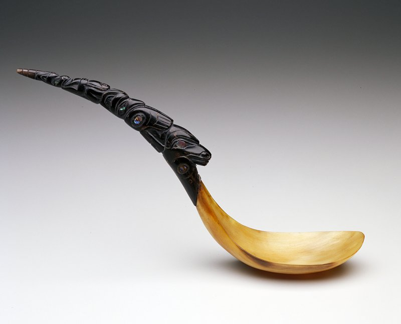 Light horn used for bowl; darker horn used for carved handle; handle is curved and is carved with totem figures; shell inlay for eyes