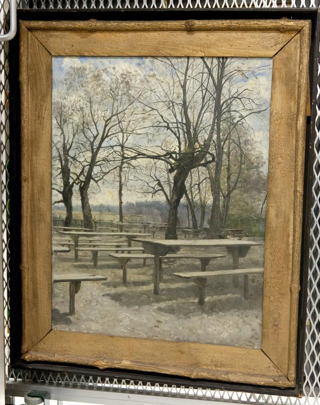 (Found in Collection 3/27/96) group of picnic tables around trees, trees do not have many leaves; frame is a black shadowbox around another gold-painted frame; edges of inner frame formed by sticks
