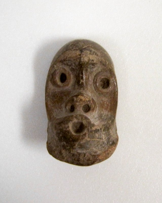 13 miniature masks, earthenware, Mexico (Tlatilco, Valley of Mexico) 1500-1150 B.C. Each measures appx.1-2 inches