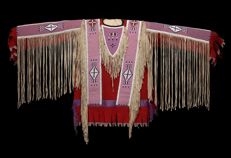 red felt shirt with beaded panels across each shoulder, on upper back and on top of each arm; fringe at edges of beaded panels; open sides with ties; triangular fringed attachments at chest