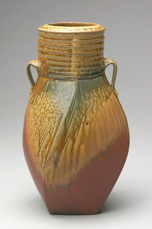 square base with walls spiraling upward; round mouth; banded neck; pair of small handles; green, tan and rust dripped glaze