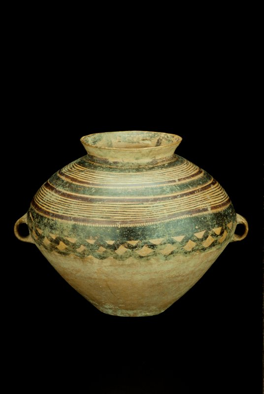 Jar of buff colored pottery, painted with conventional wave designs in black and brick red pigment. Burial urn, earthenware with painted decor. Yang-shao culture, Pan-shan stage.