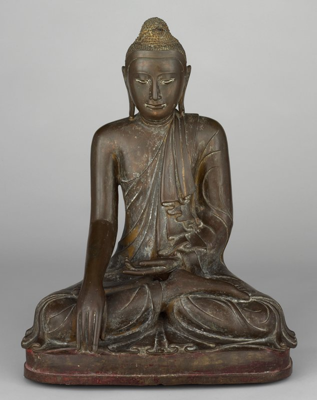 Mandalay style; Buddha seated in the bhumisparsamudra pose, his left hand is held in his lap and his right hand touches the pedestal