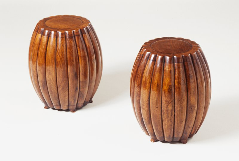 circular huang hua-li stool; four piece ribbed frame around central circle at top, ribbing of side individual pieces of wood, four piece foot with five feet