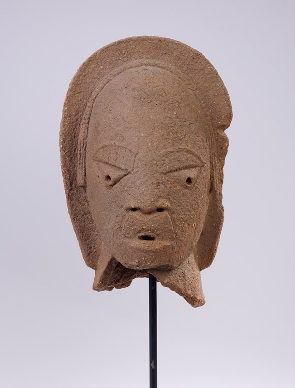 head with flat features; large eyes, small mouth; wearing a hood