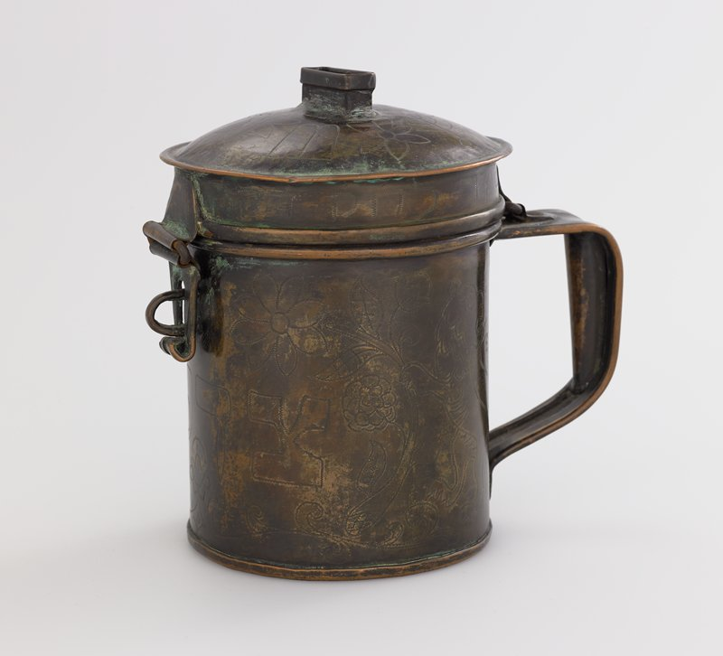 tankard shape with hinged lid and slot in top of lid; decorated with Hebrew, lions and floral motifs
