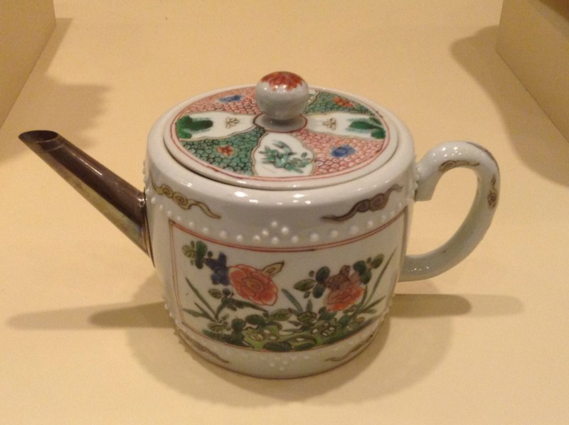 Kangxi drum-shaped famille verte teapot decorated with a panel of flowers on each side within bands of stud moulding; the original spout replaced with a silver spout