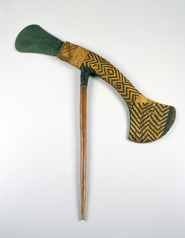 wedge-shaped blade attached to rattan-covered long wood element, flaring at opposite end; tapering wood handle at 45° angle to wood portion of axe head