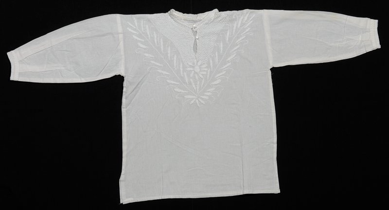 white embroidery on white fabric