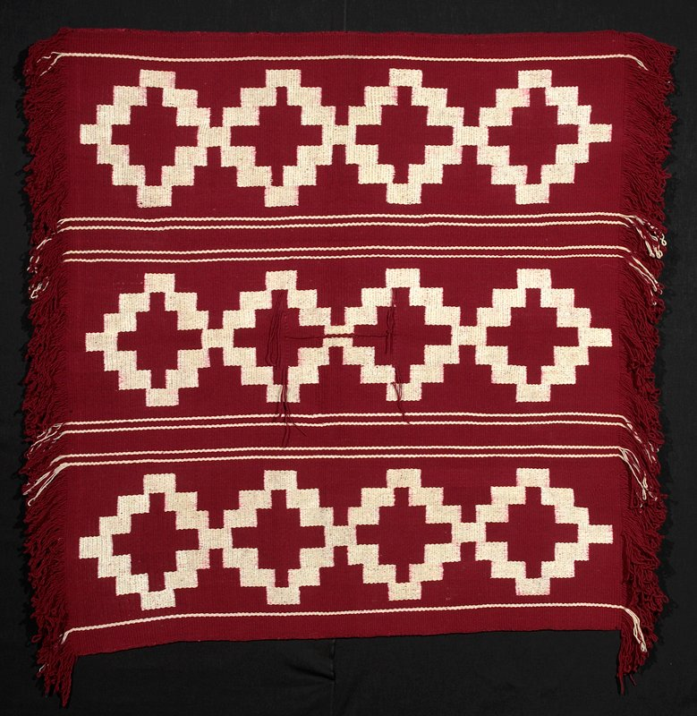 one panel; wine red background with white cross; ikat design