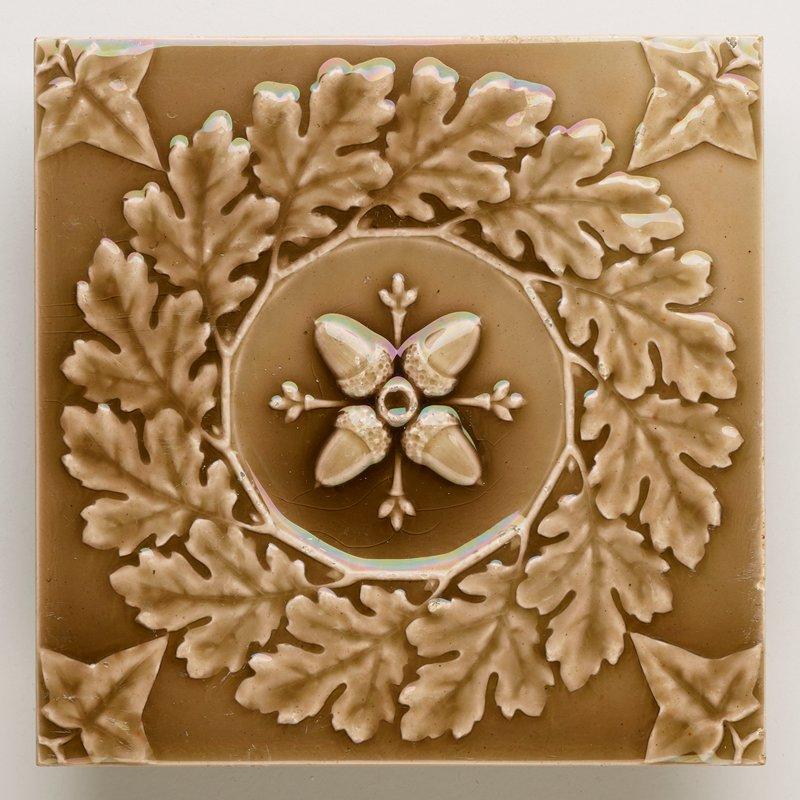 brown glaze; moulded design of oak leaf wreath surrounding 4 acorns; leaf in each corner