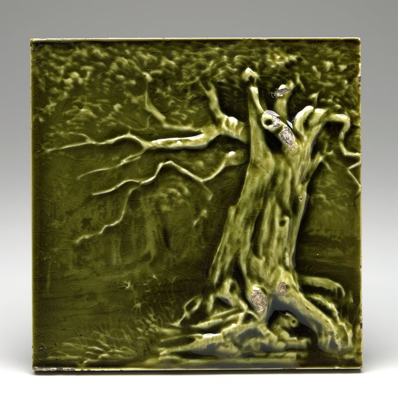 green glaze; relief design of landscape with trees and grass