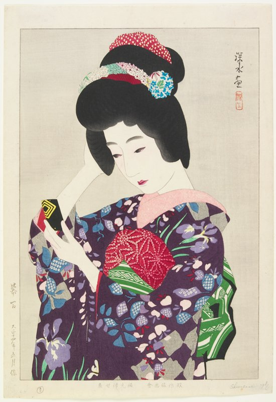 portrait; head and torso of woman wearing purple floral kimono and green and white obi; arranging her hair and looking in a small black and yellow mirror