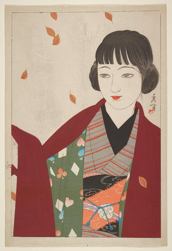 head and torso of woman with hair in 2 buns over her ears, wearing a maroon wrap over green fabric printed with hearts, spades, diamonds and clubs, grey and orange kimono and orange and black obi; brown falling leaves