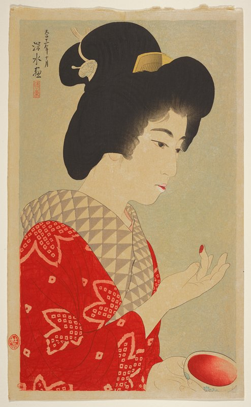 portrait; head and shoulders of a woman applying pigment to her lips with her finger, holding a blue and white container of pigment; red and white kimono with grey and white collar