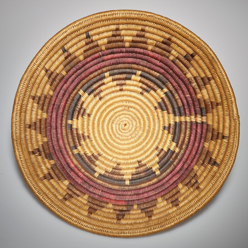 basket, straw, previously attributed to Pima; design is desert poppy in shades of purple; large shallow basket; coiled