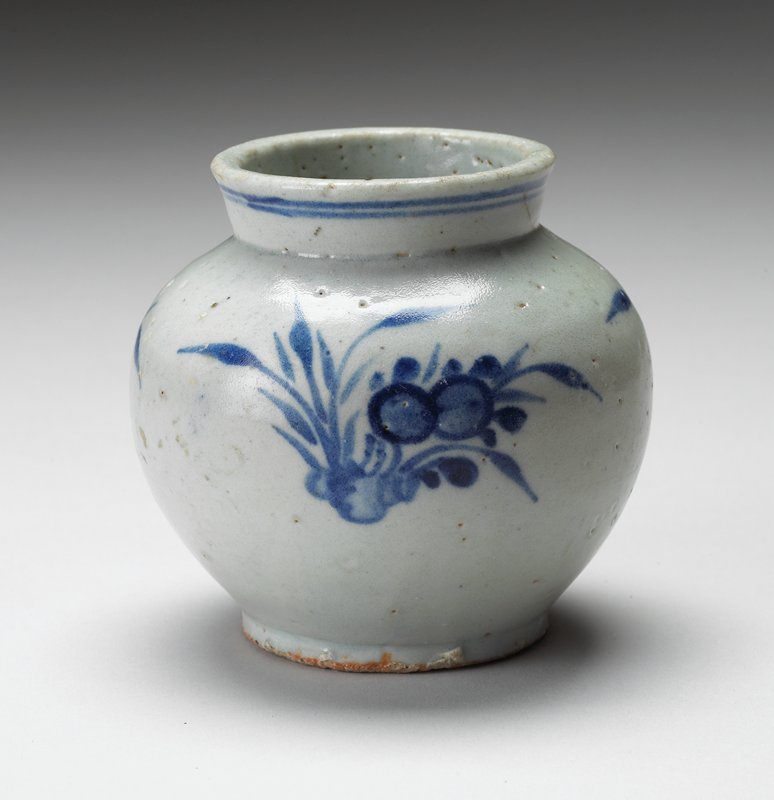 blue & white jar; foliage pattern with 2 circles repeated 3 times; 2 lines around lip of jar; other #'s J86