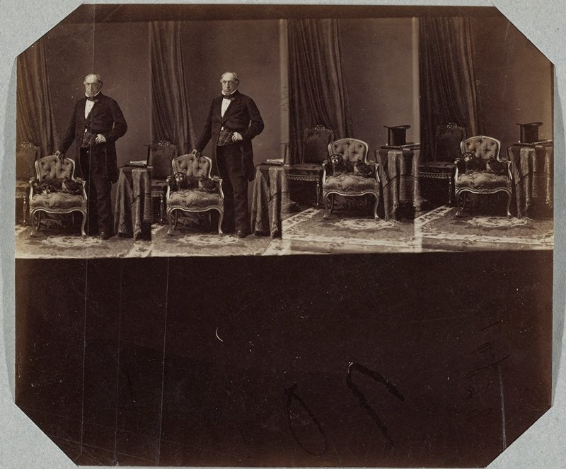 thin sheet with 4 images printed horizontally; 2 images at left of balding man with his PR hand on the back of a chair where a dog lies; 2 images at right of dog in chair, with a top hat and books on a table at right