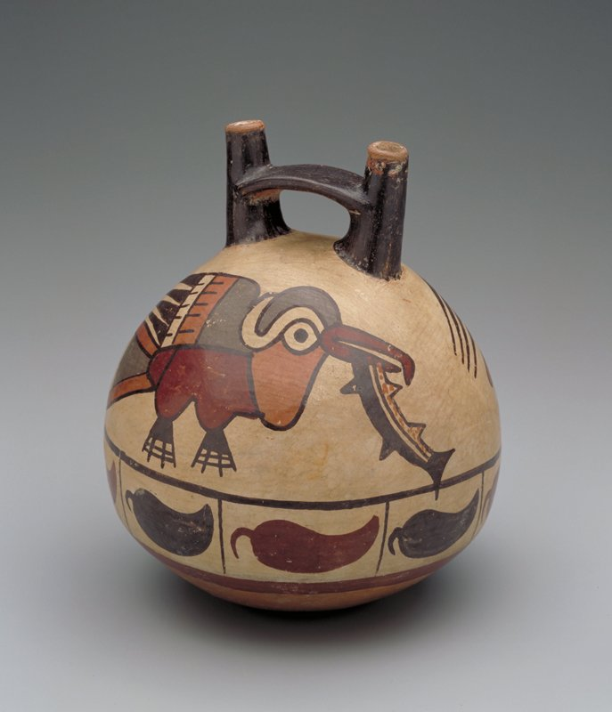 Double spout water jar decorated in polychrome with two large fishes in their mouths. Frieze of peppers below.