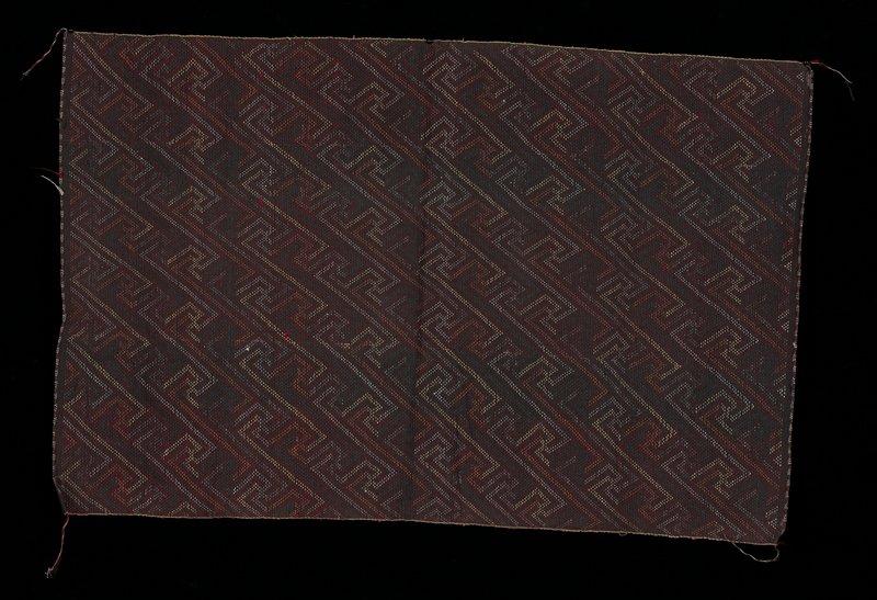 Geometric pattern in black, pink, yellow, white.