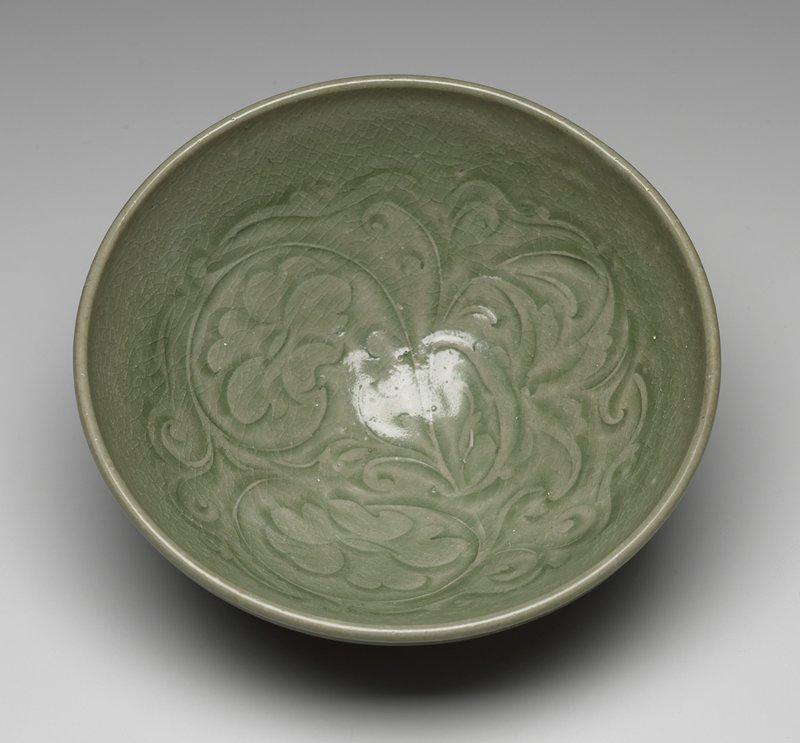 celadon green bowl; lightly incised organic design at interior; small foot