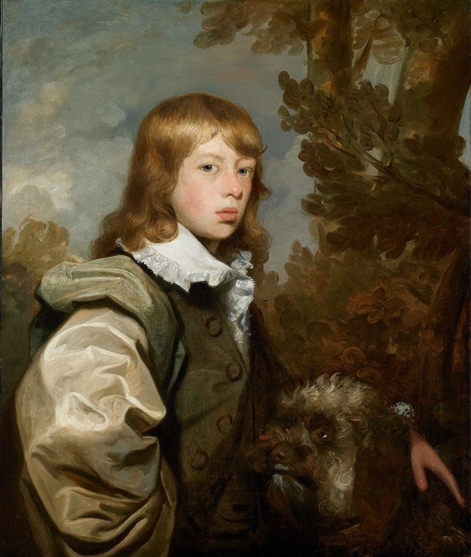 Portrait of a young boy, three quarters view, with a dog