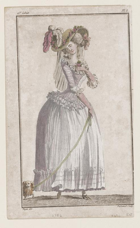 Woman in white gown with pink stripes, pink gloves, pink and white plumes on a yellow straw hat with pink flowers around the brim, holding a yellow leash with a small dog on the end of it