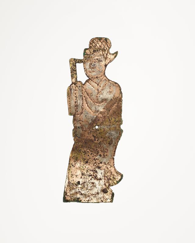 standing figure wearing robe and holding an L-shaped object; incised details; mounted on black cloth-covered board with L2003.116.5.1-2, .4-7