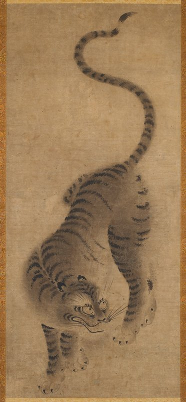 standing tiger; open mouth; looking to proper left; bronze and pale green brocade border