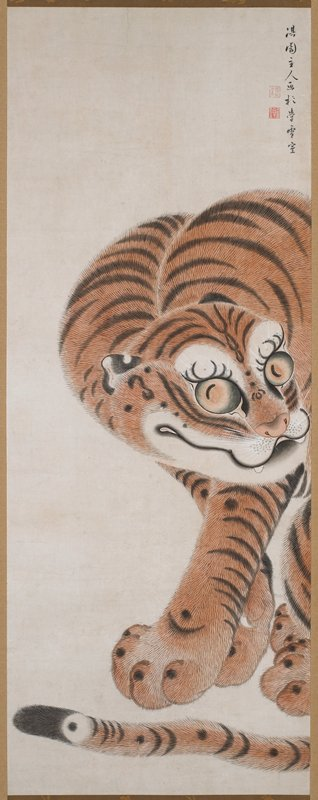 seated tiger; front half of body visible, back half cut off at R edge; head lowered and turned to R; tiger looking at viewer; tail across bottom; green and gold brocade borders; new wood roller surrounding bottom roller
