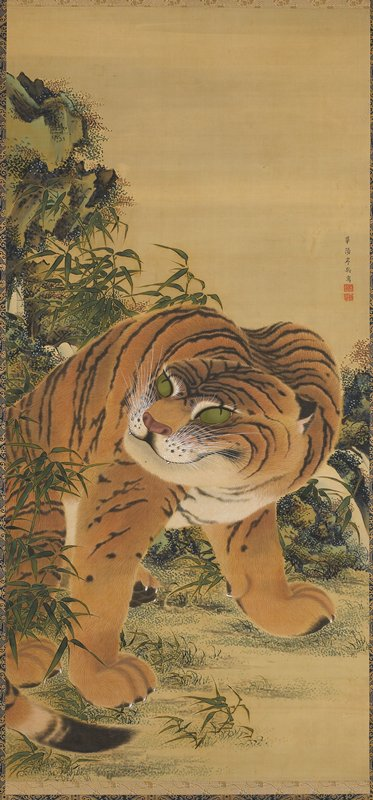 seated tiger with head turned to PR; ears back; rocks on L and foliage all around; beige and blue and gold brocade border