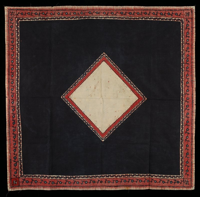 blue and red on cream; cream square in center with 2 borders, surrounded by blue field; 3 borders at edge: 2 organic, 1 geometric