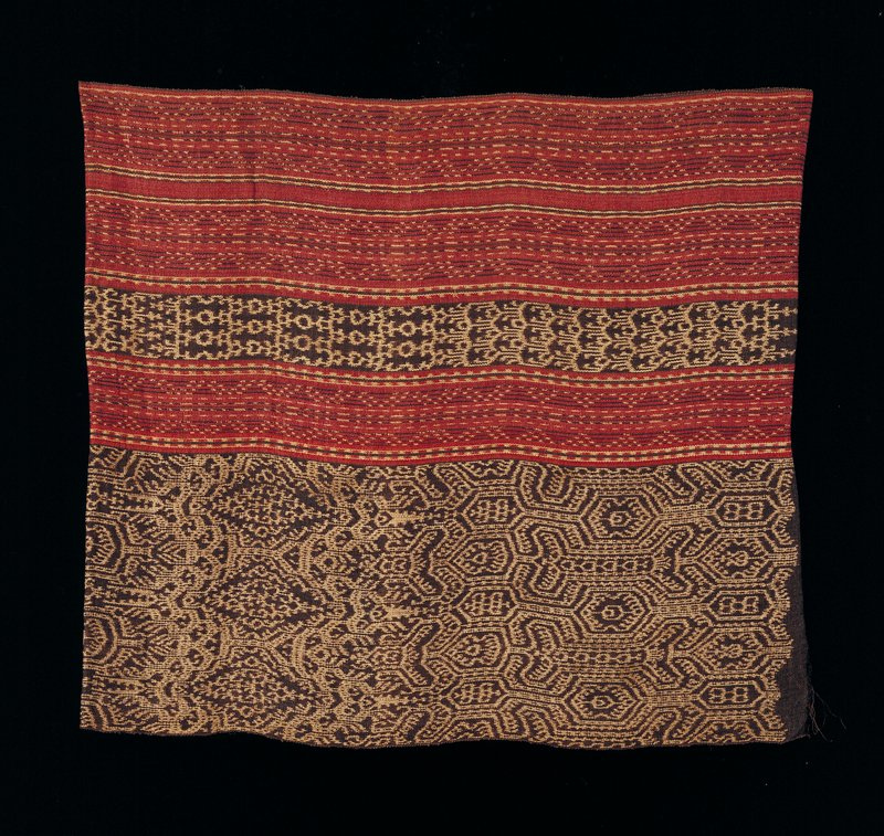 skirt; red, brown and undyed areas; four distinct bands; ikat design; two bands of thinner band, two bands of ikat repeated design; one seam, ends uneven at seam, 3-1/2 inch difference