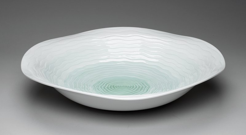 variegated light green/ white; large shallow dish with wavy radiating concentric circles; darker at center