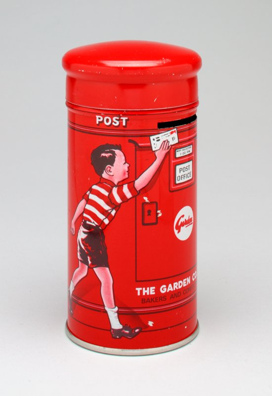 "red cylinder, printed with little boy dropping a letter in a mail slot; dog at right; ""POST OFFICE"" flanking coin slot"