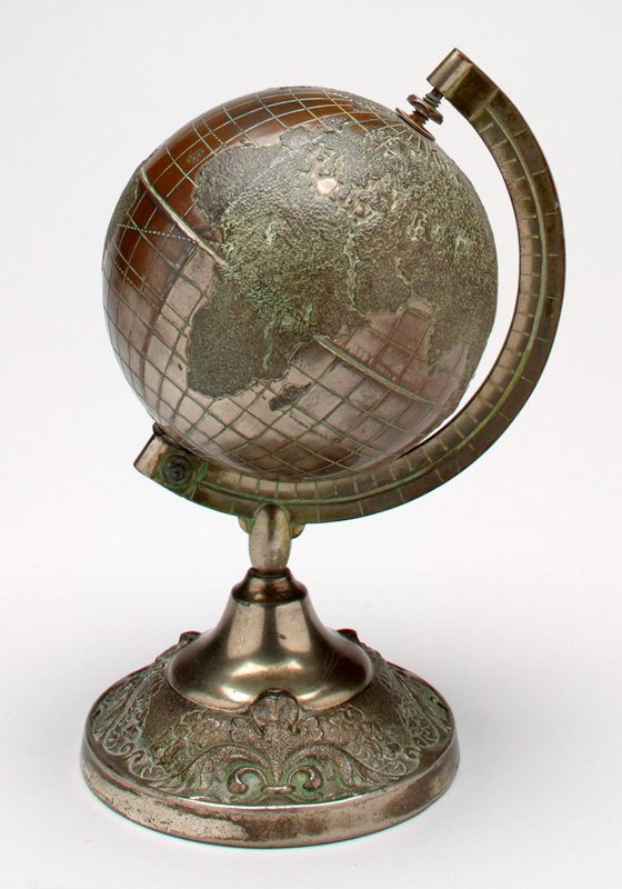 bronze colored globe on pedestal; globe rotates on axis; raised design on pedestal