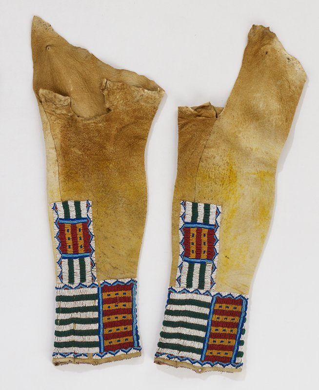 yellowish-tinted hide; bands of beading at bottom edges and in block on outside of legs; linear, rectangular and triangular designs