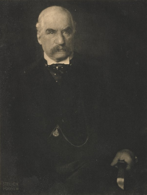 portrait of a seated male in waistcoat with picket watch and fob; proper left hand rests on arm of chair